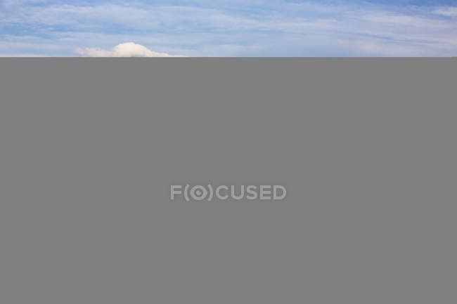 Clear sky reflected in alpine lake — Stock Photo