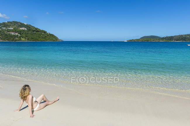 Woman relaxing on Long Bay Beach — Stock Photo