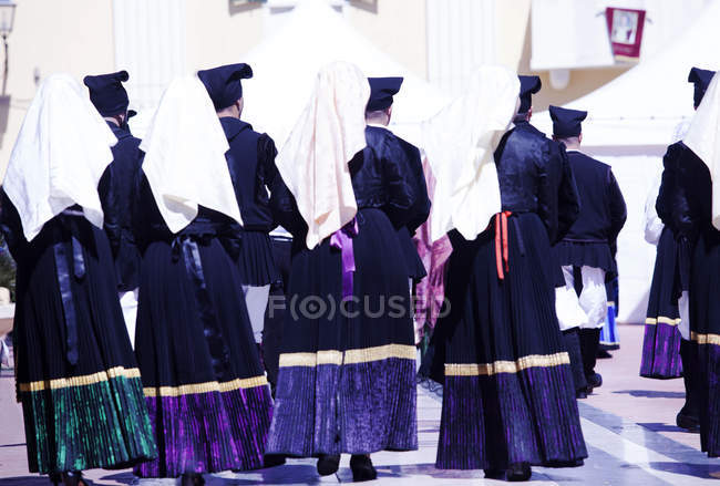 Men and women during Saint Antioco procession — Stock Photo