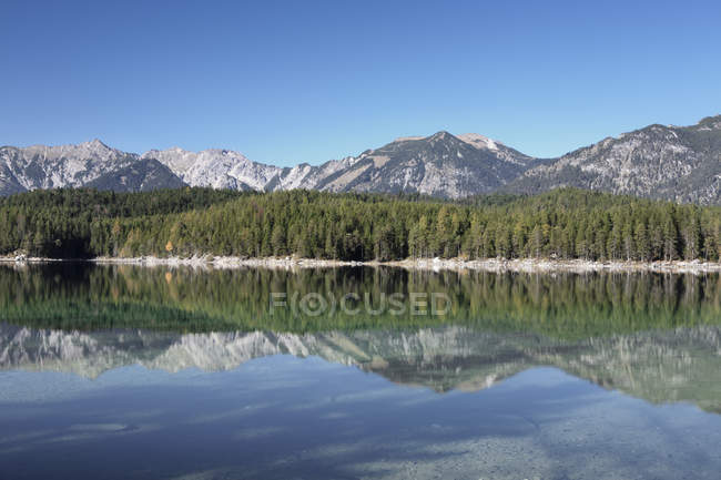 Reflections, Eibsee lake — Stock Photo