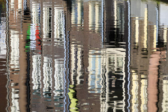 Abstract details of buildings reflected in canal — Stock Photo