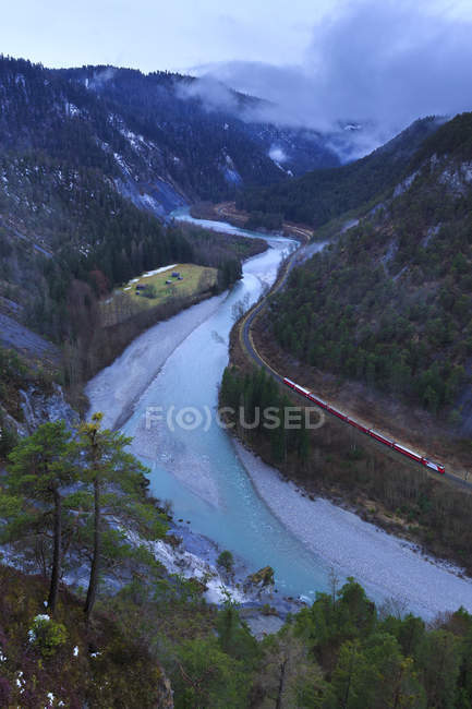 Red Train in gorge — Stock Photo