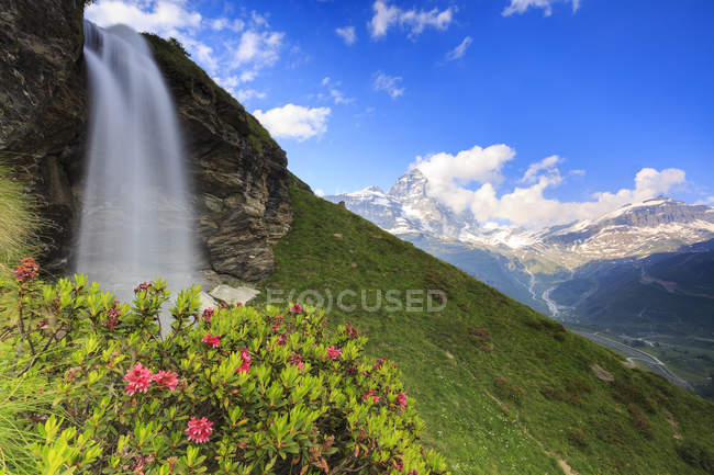 Waterfall overlooking the Matterhorn — Stock Photo