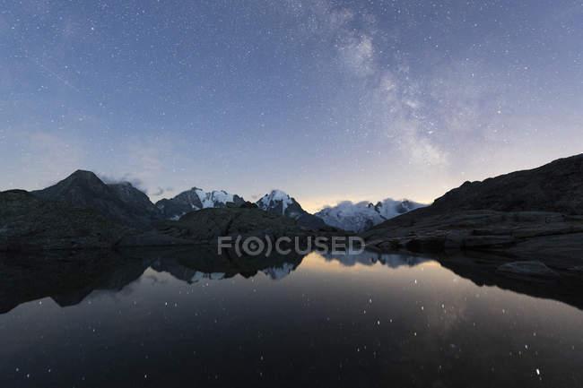 Milky way on Piz Bernina — Stock Photo