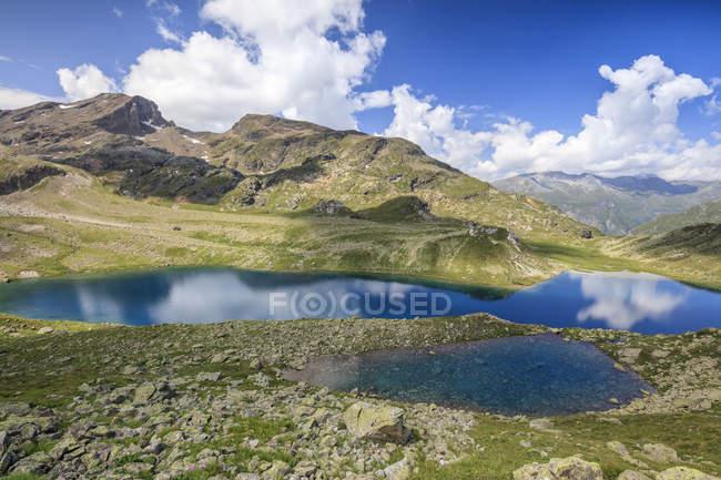 Blue water of alpine lake — Stock Photo