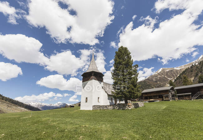 Ancient church in alpine village of Davos — Stock Photo