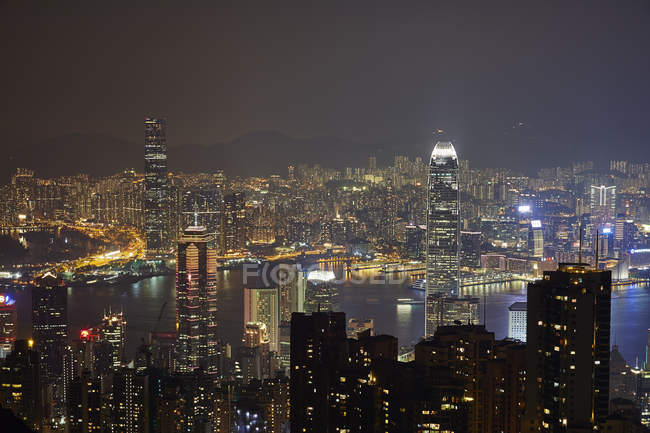Aerial view at night Hong Kong and Victoria Harbour — Stock Photo