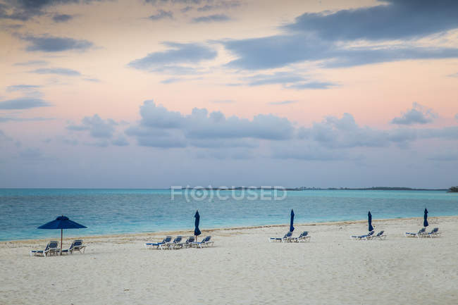 Sun loungers at empty beach — Stock Photo