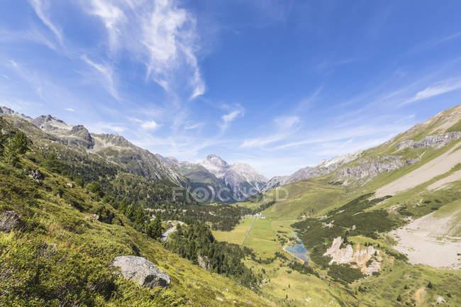 Meadows surrounding peaks of Swiss Alps — Stock Photo
