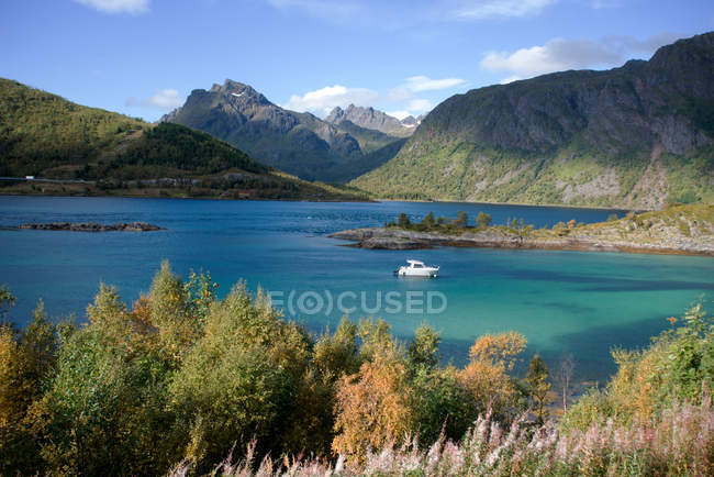Boat floating in Glacial blue lake — Stock Photo