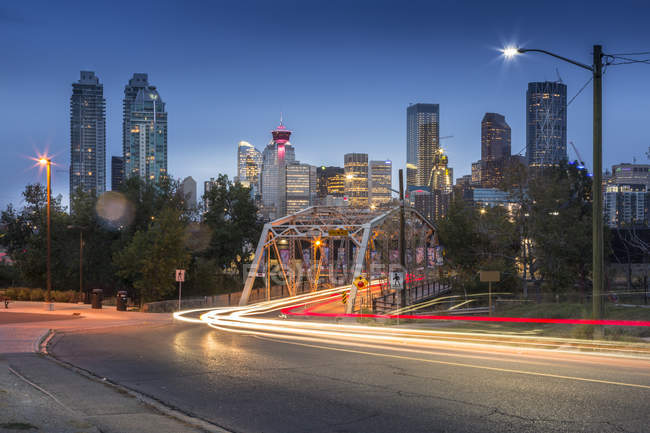 Car trail lights and Downtown skyline — Stock Photo