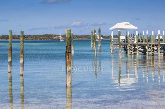Tahiti Beach with wooden posts — Stock Photo