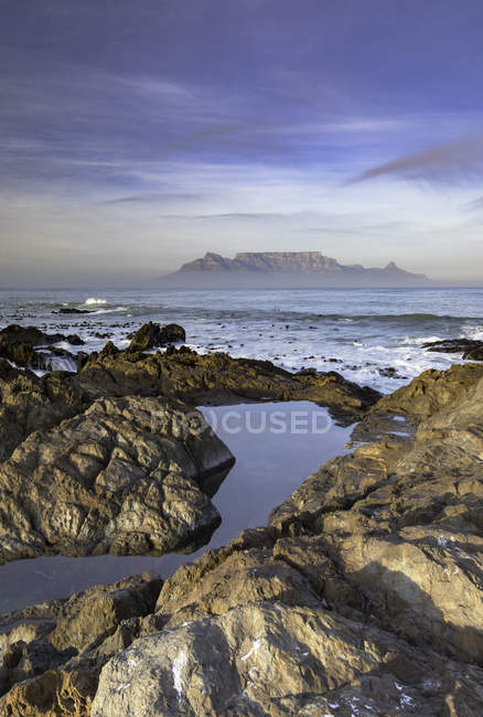 Table Mountain and rocky coast — Stock Photo