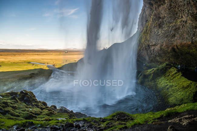Seljalandsfoss waterfall and cliff — Stock Photo