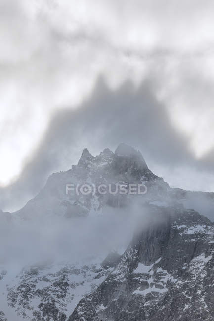 Shapes above peaks created by mist — Stock Photo