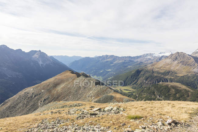 Poschiavo Valley under cloudy sky, Bernina Pass, Engadine, canton of Graubunden, Switzerland — Stock Photo