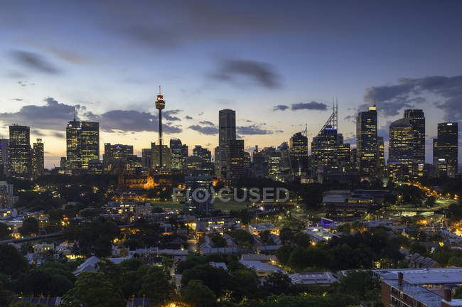 View of skyline with Sydney Tower and skyscrapers at sunset, Sydney, New South Wales, Australia — Stock Photo