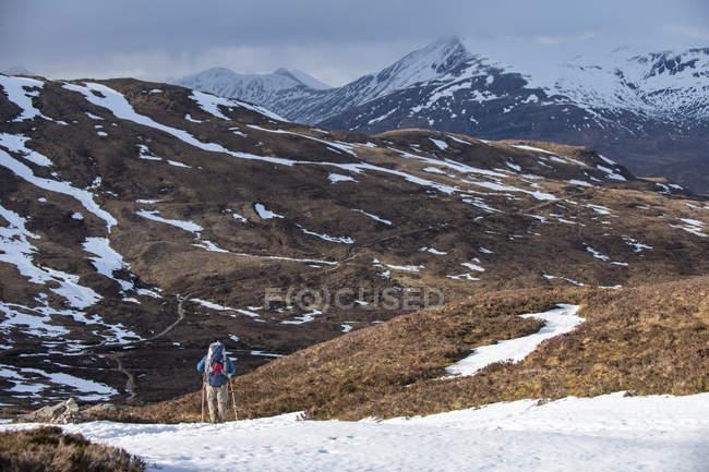 Hiker waking along the West Highland Way near Glencoe in the Scottish Highlands, Scotland, United Kingdom — Stock Photo