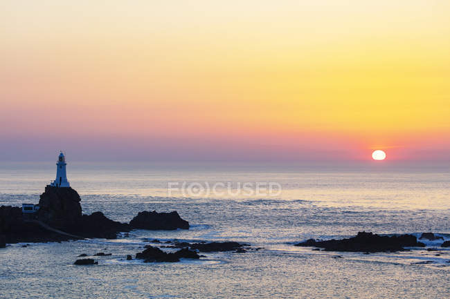 Scenery with Corbiere Point Lighthouse at sunset in Jersey, Channel Islands, United Kingdom, Europe — Stock Photo