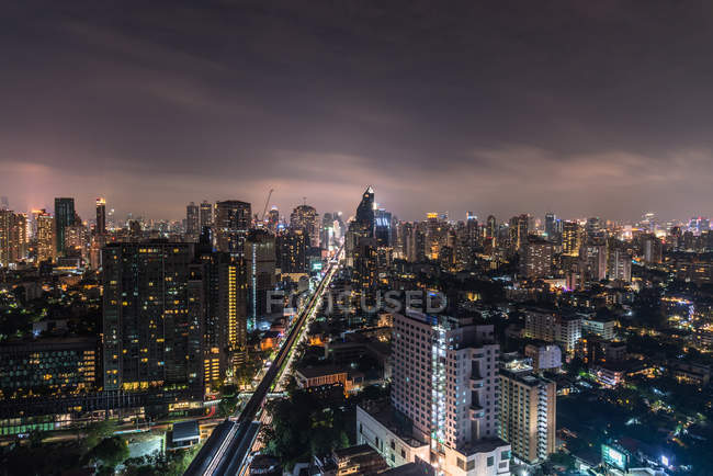 Illuminated futuristic Bangkok cityscape at night, Bangkok, Thailand, Southeast Asia, Asia — Stock Photo