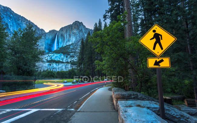 Yosemite Falls and car trail lights, Yosemite National Park, California, United States of America, North America — Stock Photo