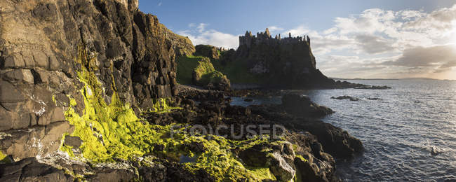 Dunluce Castle on coastal rocky cliff, County Antrim, Ulster, Northern Ireland, United Kingdom — Stock Photo