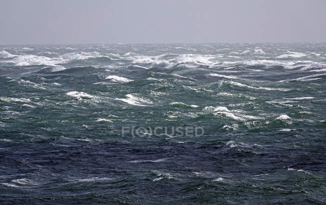 Dark stormy sea under cloudy sky — Stock Photo