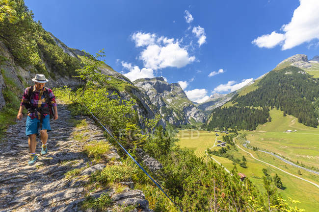 Male hiker walking along path Scala Mola, Val Bargis valley, Flims, District of Imboden, Canton of Grisons, Switzerland — Stock Photo