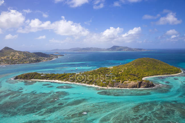 Aerial view of turquoise water surface and islands, The Grenadines, West Indies, Caribbean, Central America — Stock Photo