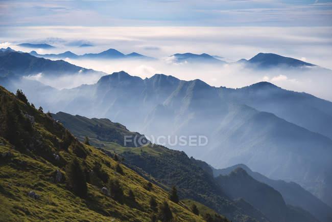 Silhouette of Brescia prealpi mountain range in autumn morning, Brescia province, Lombardy district, Italy, Europe — Stock Photo