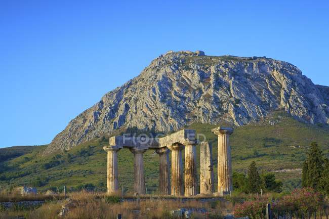 Ruin of Temple of Apollo under clear sky, Ancient Corinth, The Peloponnese, Greece — Stock Photo