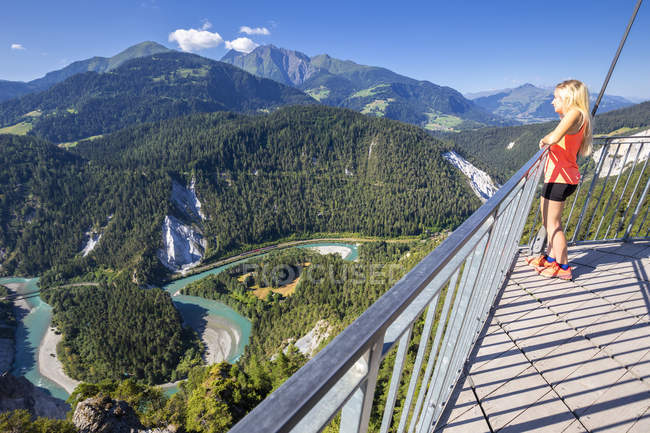 Girl looking over the river from Il Spir terrace, Rhine Gorge (Ruinaulta), Flims, District of Imboden, Canton of Grisons (Graubunden), Switzerland — Stock Photo