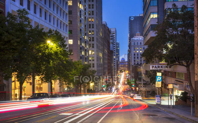 Car trail lights on Bush Street, Oakland Bay Bridge on background, San Francisco, California, United States of America, North America — Stock Photo