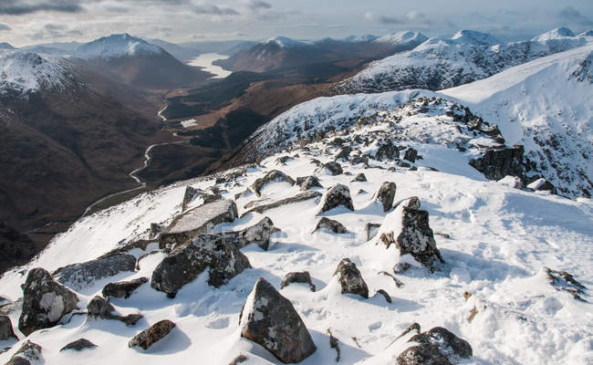 Snow covered rocky mountain peaks, Glen Etive and Loch Etive in distance, Highlands, Scotland, United Kingdom, Europe — Stock Photo