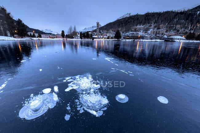 Ice bubbles in frozen Lake St. Moritz at dusk, Engadine, Canton of Graubunden, Switzerland, Europe — Stock Photo