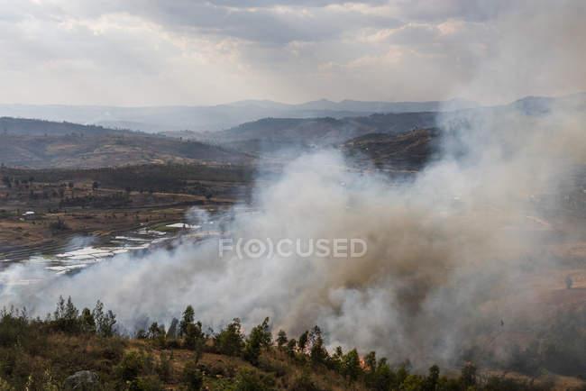 Slash and burn forest fire, Antsirabe, Vakinankaratra Region, Madagascar, Africa — Stock Photo