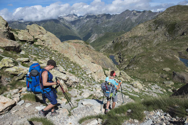 People with backpacks hiking GR10 trekking trail, Pyrenees Atlantiques, France, Europe — Stock Photo