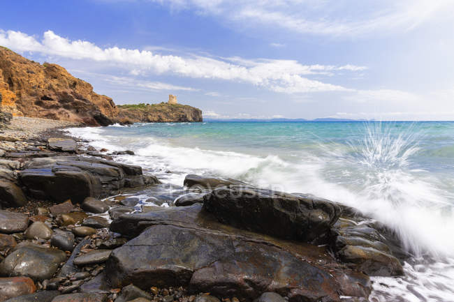 Wave breaking on rocks on beach, Sud Sardegna province, Sardinia, Italy, Mediterranean, Europe — Stock Photo