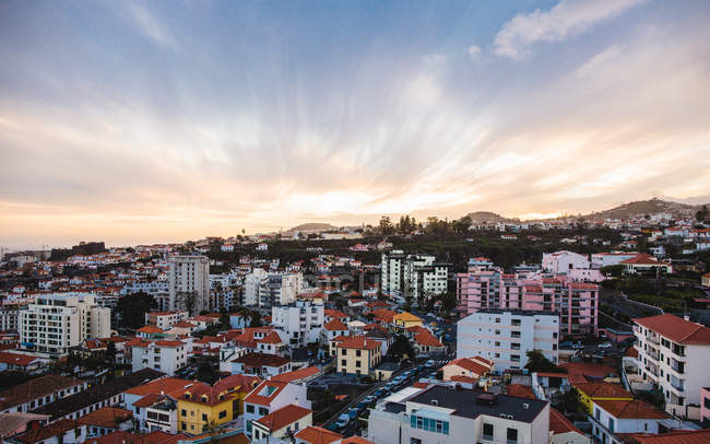 Sunset over buildings in Funchal city, Madeira, Portugal, Atlantic, Europe — Stock Photo