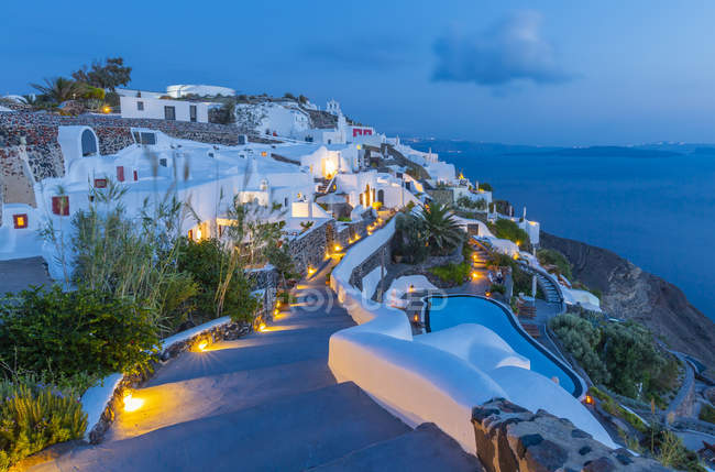 View of illuminated Oia village at dusk, Santorini, Cyclades, Aegean Islands, Greek Islands, Greece, Europe — Stock Photo