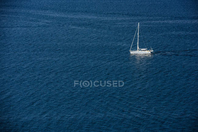 Yacht floating on sea water surface in Corfu, Greece, Europe — стокове фото