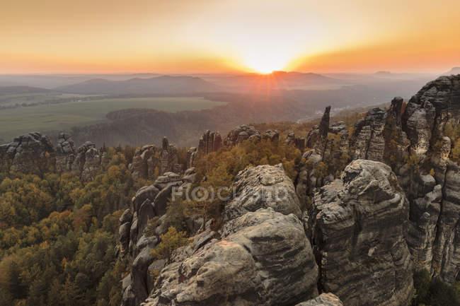 Schrammsteine rocks at sunset in Elbe Sandstone Mountains, Germany, Europe — Stock Photo