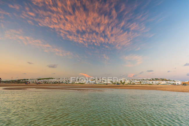Conil de la Frontera coastal town under picturesque dramatic sky at sunset in Andalusia, Spain, Europe — Stock Photo