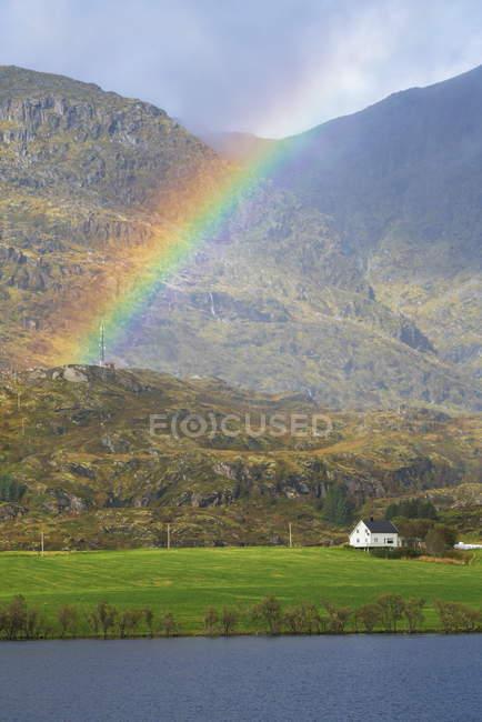 Rainbow over picturesque mountains in Leknes, Lofoten Islands, Norway, Europe — стоковое фото