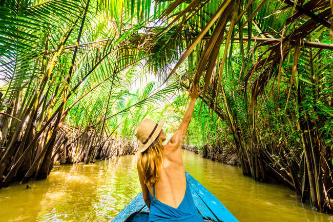 Woman in hat sailing in tributaries of the Mekong River, Vietnam, Indochina, Southeast Asia, Asia — Stock Photo