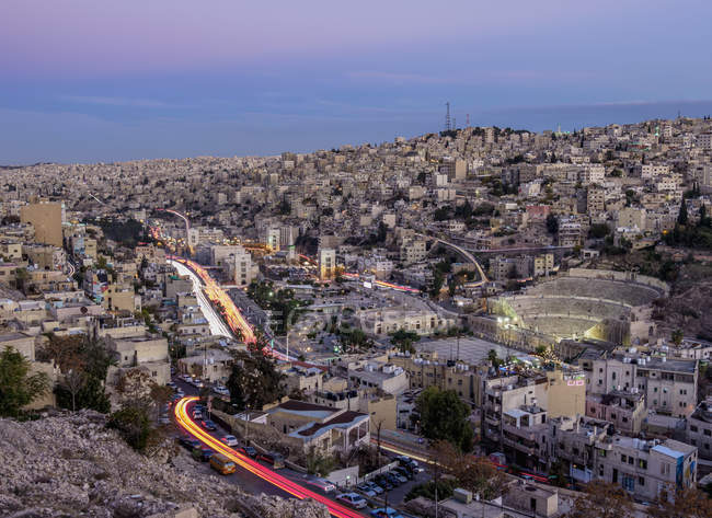 Cityscape with light trails seen from Citadel Hill at dusk, Amman, Amman Governorate, Jordan, Middle East — Stock Photo