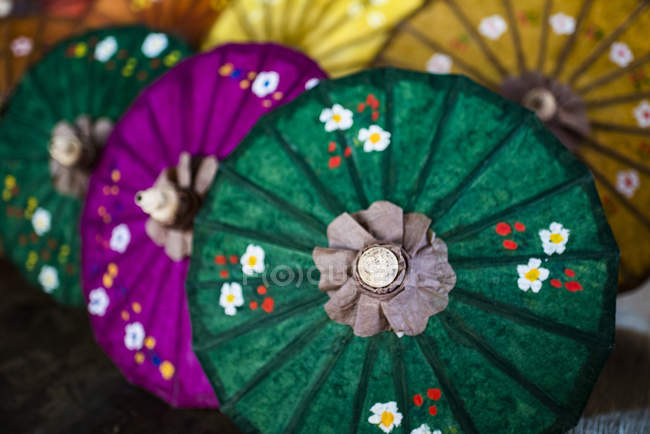 Traditional asian decorated sun umbrellas — Stock Photo
