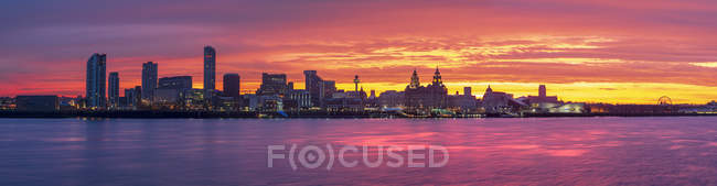 Panoramic view of The Liverpool waterfront at amazing sunrise, Liverpool, Merseyside, England, United Kingdom, Europe — Stock Photo
