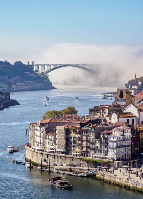 View towards traditional shabby architecture and Arrabida Bridge, Porto, Portugal, Europe — Stock Photo