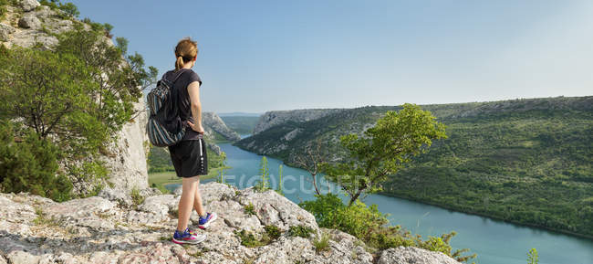 Hiker at standing view point over Krka River, Krka National Park, Dalmatia, Croatia, Europe — Stock Photo
